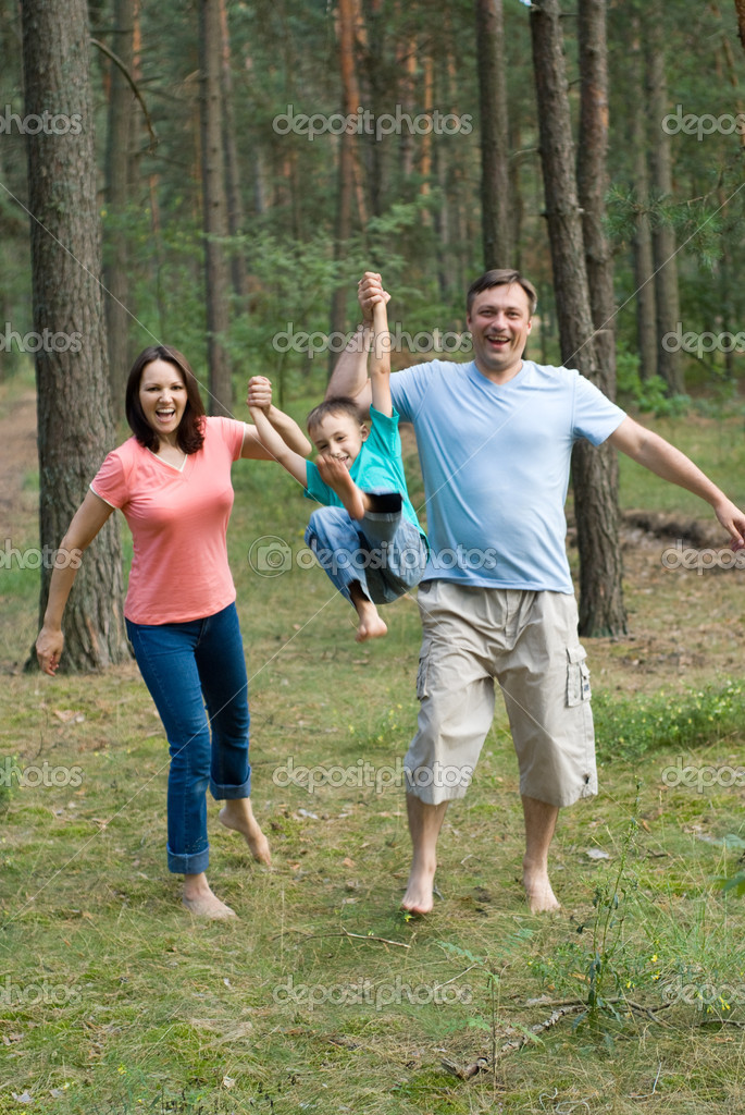 Family rambling in the forest — Stock Photo #5199936