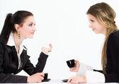 Two beautiful businesswomen sitting — Stock Photo