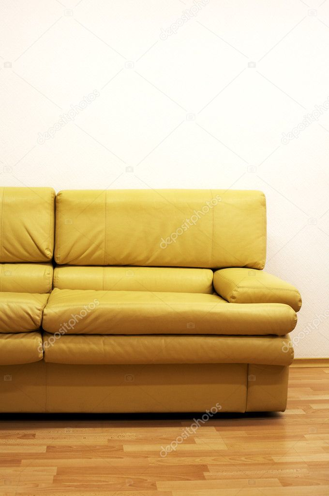 Yellow sofa at a wall at modern office  Stock Photo #4241719