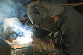 Worker is engaged in welding — Stock Photo