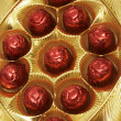 Chocolates in a red foil — Stock Photo