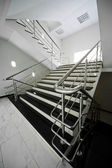 Staircase with a steel handrail — Stock Photo