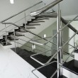 Stock Photo: Staircase with steel handrail
