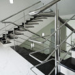图库照片: Staircase with steel handrail