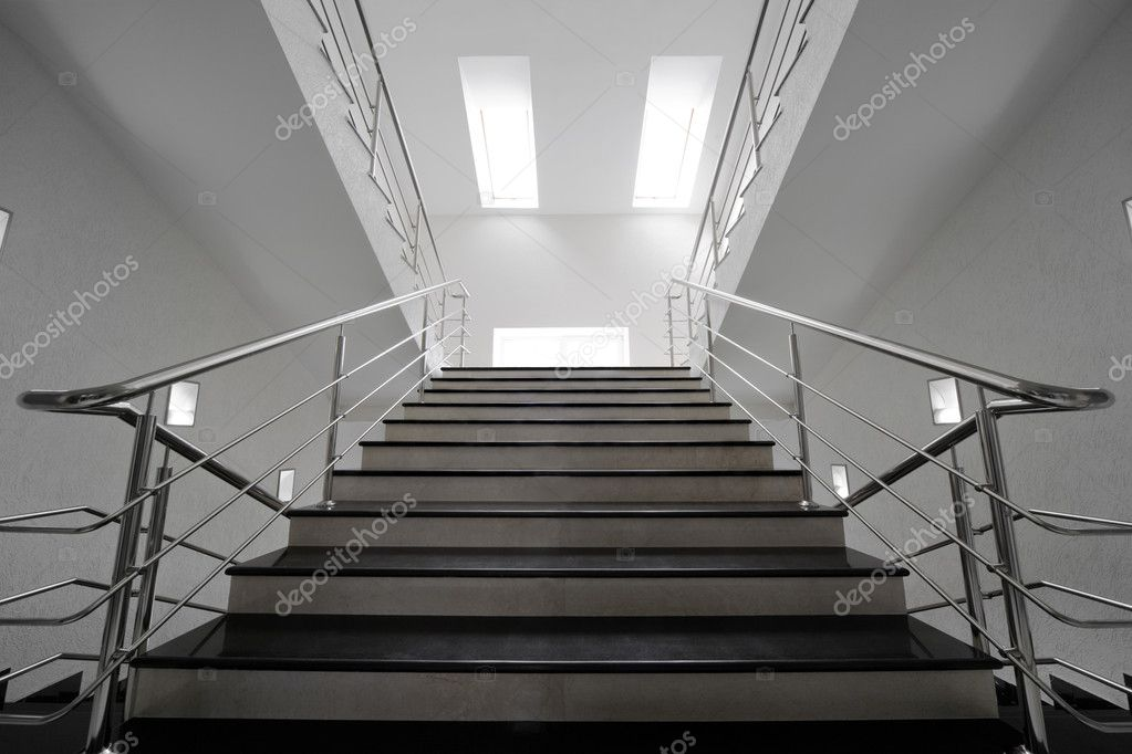Marble staircase with a steel handrail in a modern building  Stock Photo #4493038