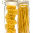 Pasta in glass can - Stock Photo