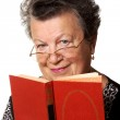 Old woman with the red book — Stock Photo