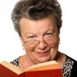 Old woman with the book — Stock Photo
