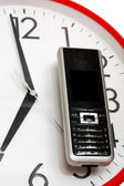 Modern phone and clock — Stockfoto
