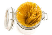 Pasta in glass can — Stock Photo