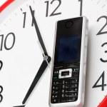 Phone and clock — Stock Photo #4559989
