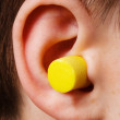 Stock Photo: Yellow earplug