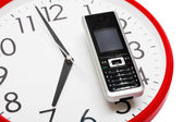 Phone and clock — Stockfoto