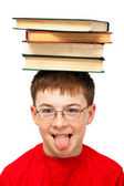 Boy on head with books — Stock Photo