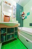 Green bathroom — Stock Photo