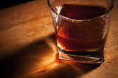 Whisky on a wooden table — Stock Photo