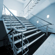 Staircase with a steel handrail - Stockfoto