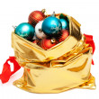 Gold bag with Christmas balls — Stock Photo