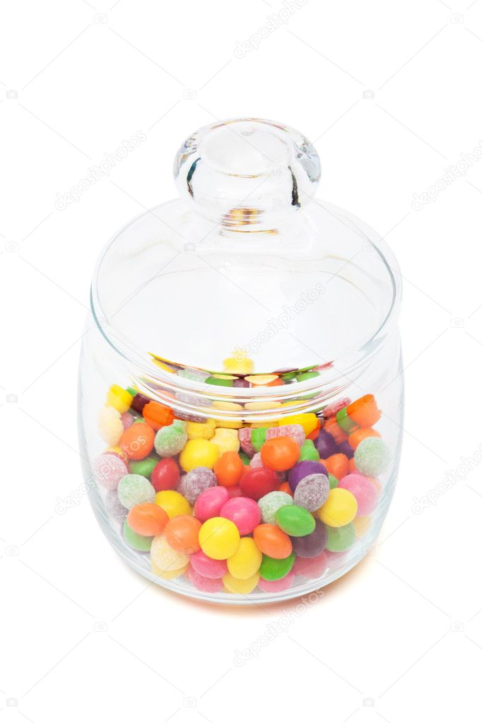 Candy in a glass jar on white background — Stock Photo #5242031