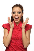 Girl in red blouse happily surprised (white background) — Stock Photo