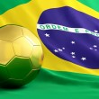 Golden ball on braziliflag background — Stock Photo #4132184