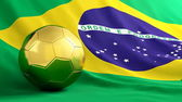 Golden ball on brazilian flag background — Stock Photo