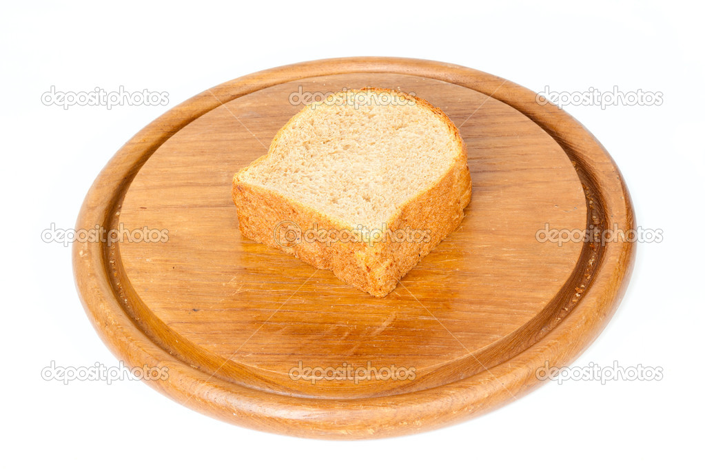 Sliced bread on round desk isolated on white background — Stock Photo #5324059