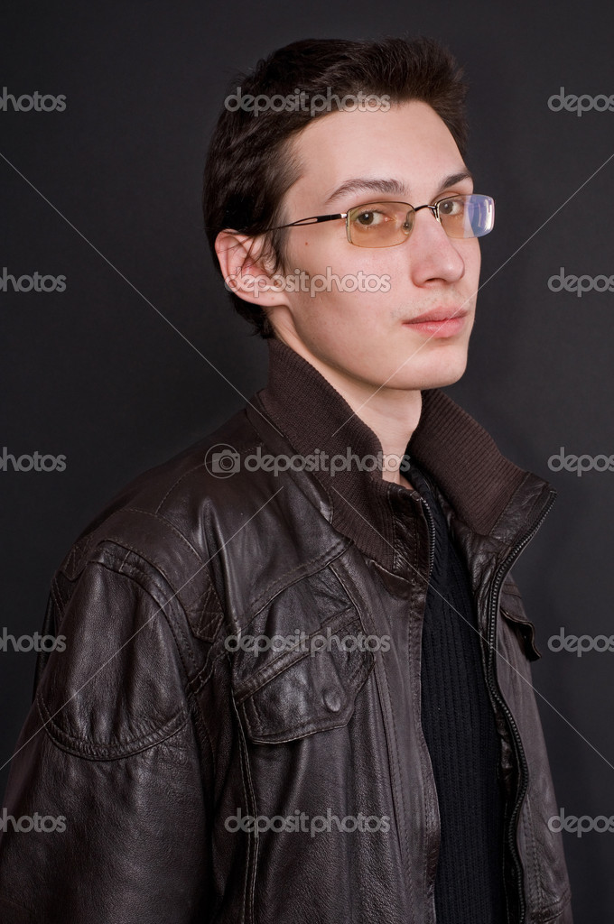 Serious young man in glasses on a black background — Stock Photo #3982394