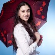 Attractive woman with umbrella — Stock Photo