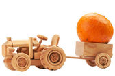 Toy tractor with orange pumpkin. — Stock Photo