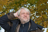 Portrait of middle-aged man in autumn day. — Stock Photo