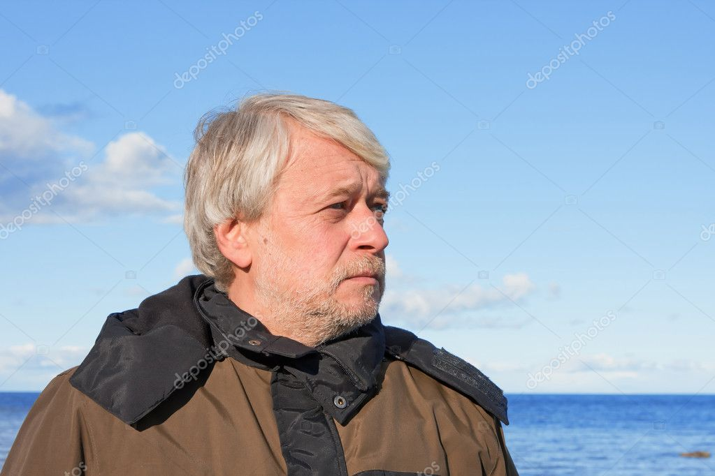 Portrait of middle-aged man at the sea. — Stock Photo ...