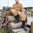 Retro style picture with soldier sitting on the bundles — Stock Photo