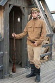 Retro style picture with soldier at sentry. — Stock Photo