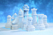 Chess figures under snow — Stock Photo