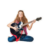 Young girl with a guitar — Stok fotoğraf