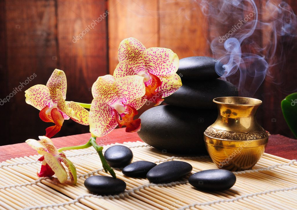 Spa concept with orchid and zen stones — Stock Photo #4349765