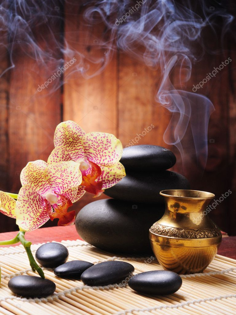 Spa concept with orchid and zen stones  Zdjcie stockowe #4350061
