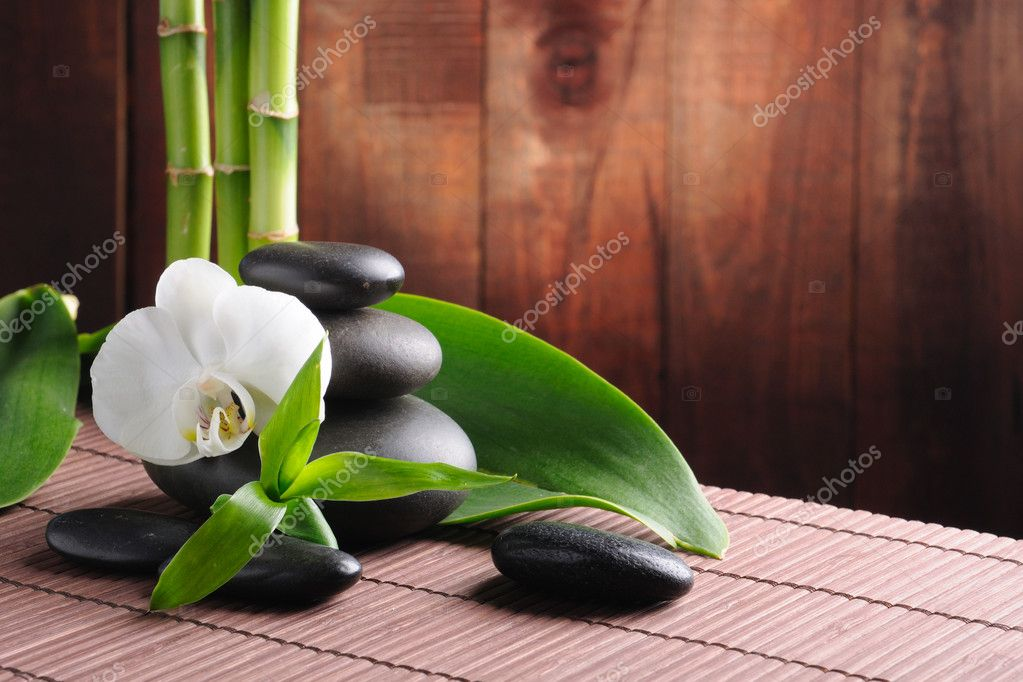 Spa concept zen basalt stones and  orchid  Foto Stock #4810760