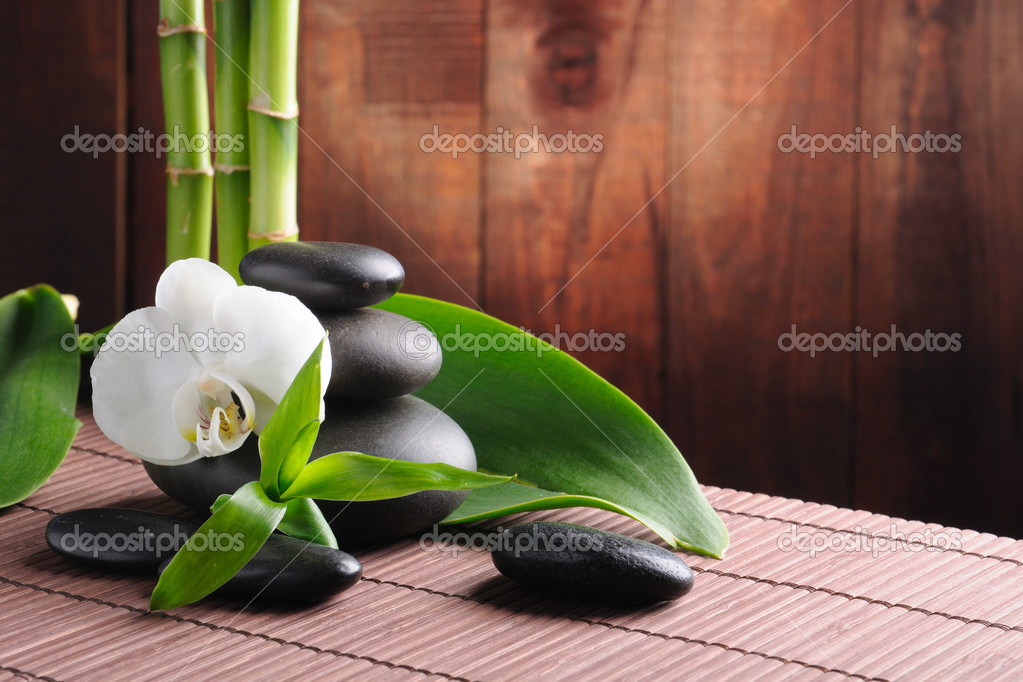 Spa concept zen basalt stones and  orchid — Stockfoto #4810760