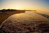Sunrise with wave on beach — Stock Photo