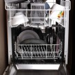 Stock Photo: Dishwasher with dishes and utensil