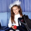 Schoolgirl girl with laptop, backpack and red apple in sofa — Stock Photo