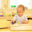 Baby playing with toy blocks — Stock Photo