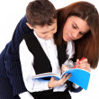 Stock Photo: Teacher or mom and boy with book isolated on white
