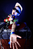 Cool kid DJ in action with mic — Stock Photo