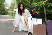 Runaway Bride hitch-hiking at the road — Stock Photo