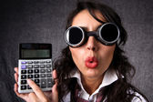 Woman with calculator — Stock Photo