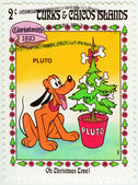 Disney Pluto at Christmas tree — Stock Photo