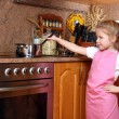 Girl cooking in the Kitchen — Stock Photo
